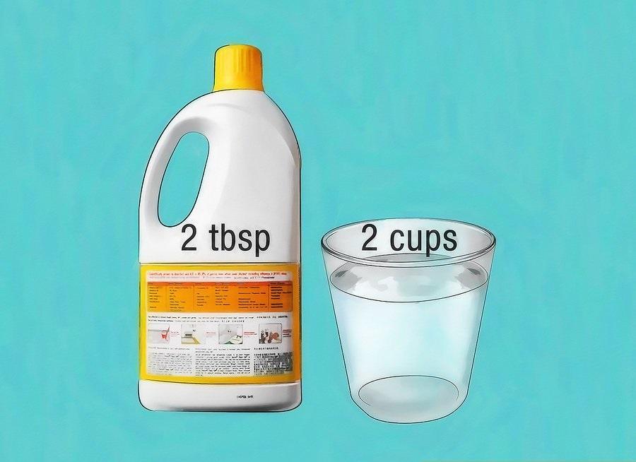 Hòa tan 2 muỗng canh dung dịch oxy hóa vào 2 ly nước ấm